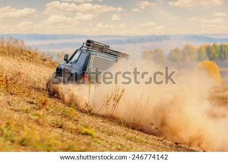 Offroad vehicle in motion on rally competition - stock photo