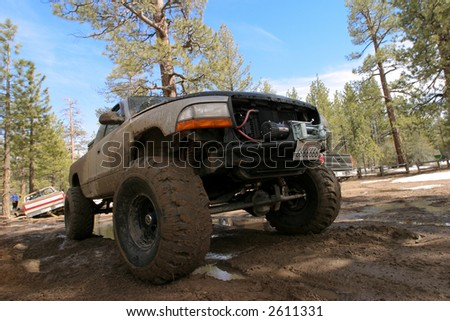 Offroading monster truck in the forest - stock photo