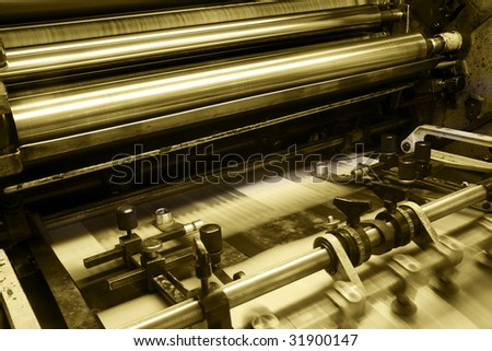 Offset press machine in printing house - stock photo