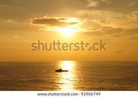 Offshore Boat for Offshore Crew Before Sunset (Golden Sky) - stock photo