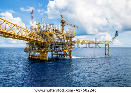 Offshore construction platform for production oil and gas, Oil and gas industry and hard work, Production platform and operation process by manual and auto function - stock photo
