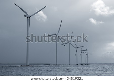 Offshore Danish wind farm form Jutland, Denmark. Roenland Wind Park. Blue toned.