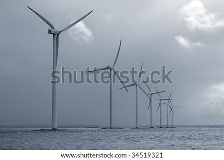 Offshore Danish wind farm form Jutland, Denmark. Roenland Wind Park. Blue toned. - stock photo