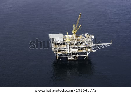 Offshore drilling platform aerial view - stock photo