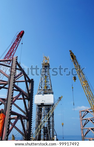 Offshore Drilling Rig (Jack Up Rig) With Rig Cranes - Petroleum Industry - stock photo