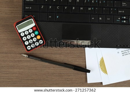 "Offshore finances and online banking security concept - digital password generation device lies on notebook near pen over standard ""power of attorney"" document on writing desk - stock photo"