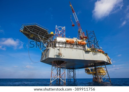 Offshore oil and gas drilling rig is drilling for exploration and production - stock photo