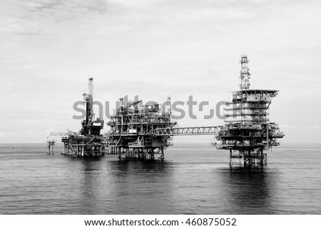 Offshore oil and gas rig platform in high contrast mono style in the middle of South China Sea.Construction of production process in the sea. Power energy of the world.