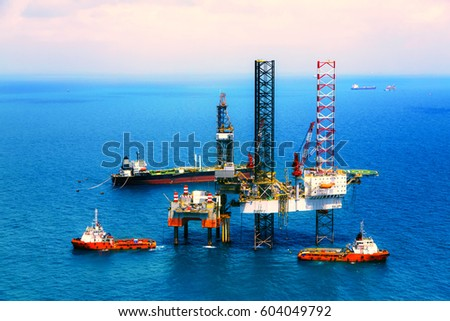 Offshore oil rig drilling platform in the gulf view from aerial,vintage film color.