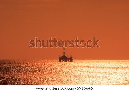 Offshore oil rig during sunset  in Caspian sea - more similar photos in my portfolio - stock photo