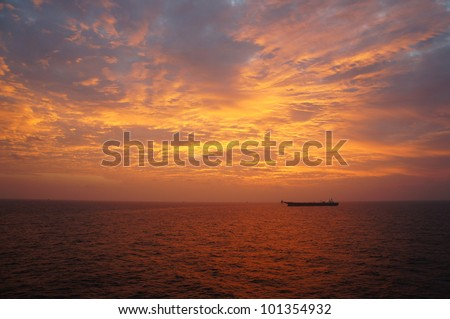Offshore Oil Tanker in The Middle of The Sea at Sunset Time - stock photo