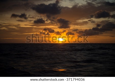 Offshore Sun Set in The Middle of The Ocean (Red and Yellow Sky)