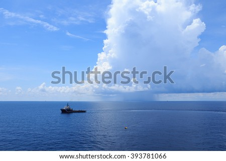 Offshore Supply Vessel For Oil Drilling Rig in The Middle Of Ocean - stock photo