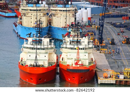 Offshore supply vessels tied up at a commercial pier in St. John's, Newfoundland, Canada. - stock photo