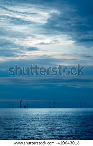 Offshore wind farm early morning - stock photo