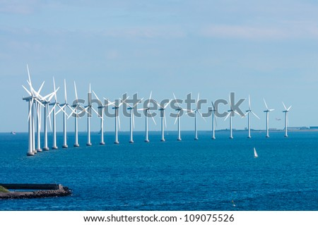 offshore wind farm in Baltic Sea off Copenhagen, Denmark - stock photo