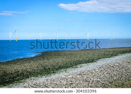 Offshore Wind Turbine in a Wind farm under construction off the England coast - stock photo