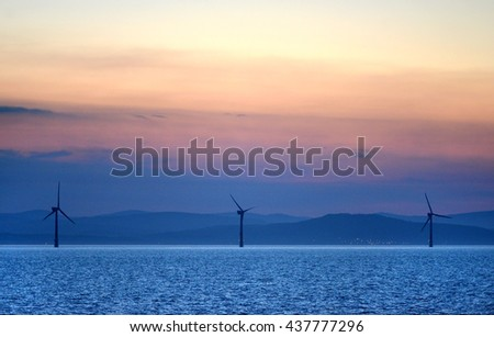 Offshore wind turbines at sunset off the Irish coast
