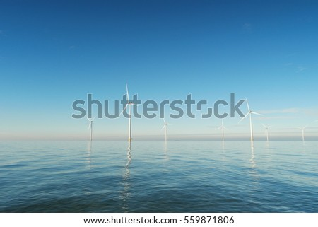 Offshore Windmill farm Westermeerwind windmills on a cold snowy winter morning by Urk Flevoland Noordoostpolder January 2017