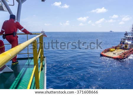 Offshore worker monitoring work activities of anchor handling tug during anchor handling operation at offshore Terengganu, Malaysia