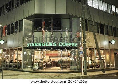 OGAWAMACHI, TOKYO - MAY 7: Starbucks Coffe shop in Chiyoda ward on May 7, 2014. Around 1,000 branches in Japan. Offers smoke free environment, which is not common in Japan, for enjoying cofee aroma. - stock photo
