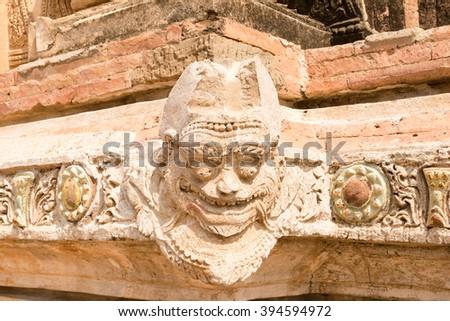 Ogress carving and ceramic decoration around the Sulamani Phaya Temple, Bagan, Myanmar - stock photo