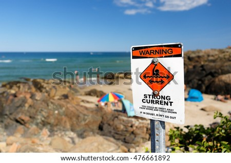 Ogunquit, Maine - August 27, 2016: Swimming Warning Sign at Ogunquit Beach , Ogunquit, Maine.