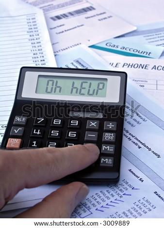 OH HELP-  Calculator & bills - stock photo