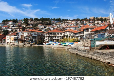 OHRID, MACEDONIA - MARCH 23, 2014: View of Ohrid old town and old fortress from a boat. Lake Ohrid is one of the most famous holiday destinations in the Balcans.