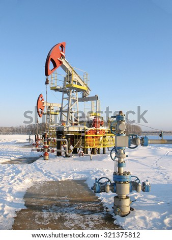Oi industry and gas industry. Work of oil pump jack on a oil field. Oil equipment - stock photo