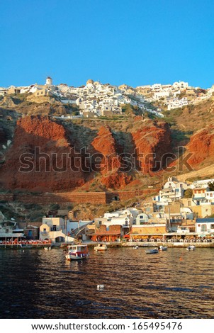 OIA, GREECE - AUGUST 10: Amoudi bay on August 10, 2013 in Oia, Greece. - stock photo