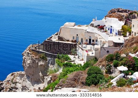 Oia, Santorini Island, Greece - June 06, 2011: Greek island village life - stock photo