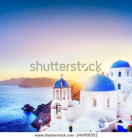 Oia town on Santorini Greece at sunset. Traditional and famous white houses and churches with blue domes over the Caldera, Aegean sea - stock photo