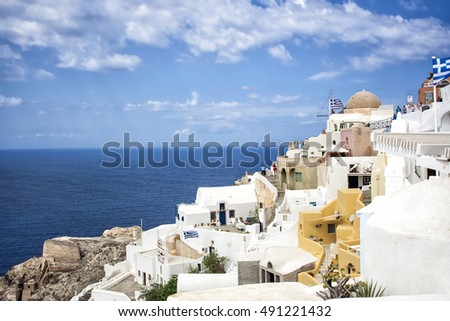 Oia town on Santorini island, Greece. Traditional and famous houses and churches over the Caldera, Aegean sea