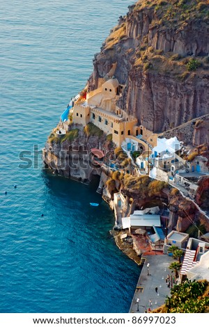 Oia village in Santorini island in Greece. (View of the sea and the village) - stock photo