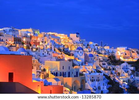 Oia village on Santorini island at nighttime - stock photo