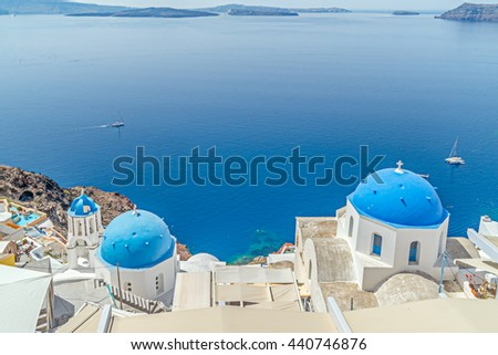 Oia village on top of the cliffs on Santorini in the Greece Islands - stock photo