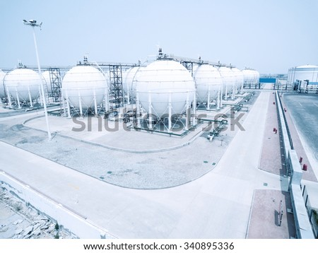 oil and fuel tanks in oil depot, empty road front - stock photo