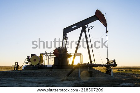 Oil and Gas. A Pump Jack in an oilfield in Southern Alberta - stock photo