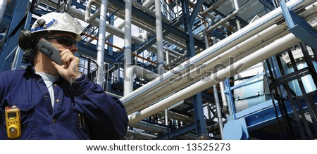oil and gas and pipelines with engineer talking in phone., panorama - stock photo