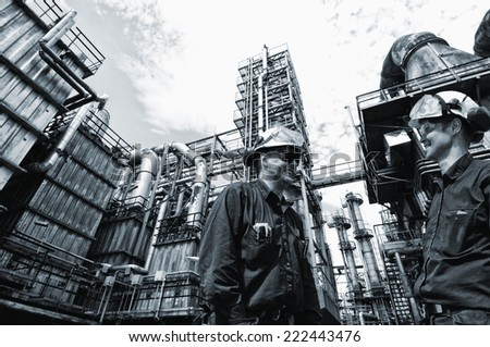 oil and gas engineers inside chemical oil refinery - stock photo