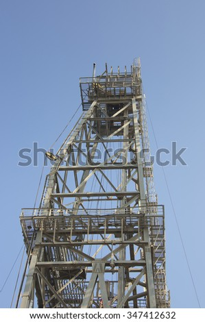 Oil and gas exploration and production Jack up drilling rig equipment detail. General view of  welded steel lattice leg structure