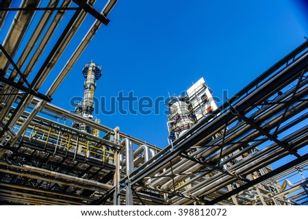 Oil and gas industry against the blue sky - stock photo