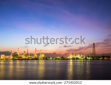 Oil and gas industry - petrochemical plant  with reflection over the river - stock photo