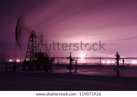 Oil and gas industry. Pump jack. Monochrome. Winter night view. - stock photo