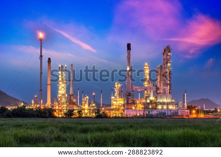 Oil and gas industry - refinery at sunrise - factory - petrochemical plant - stock photo