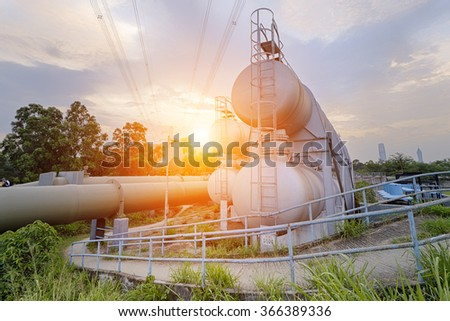 Oil and gas industry refinery factory at sunset, petrochemical plant - stock photo
