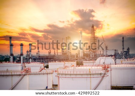 Oil and gas industry - refinery factory - petrochemical plant at sunset - stock photo