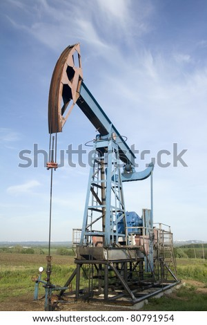 Oil and gas industry. Work of oil pump jack on a field. Environment damage - stock photo