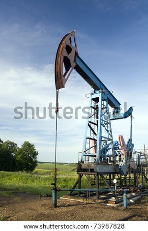 Oil and gas industry. Work of oil pump jack on a oil field - stock photo